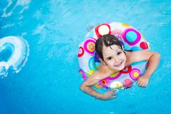 Free Little Girl In Swimming Pool With Float Ring Stock Photography - 118760322