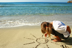 Little Girl In The Sand On The Beach Stock Image