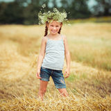 Little Girl In Wreath Of Flowers Royalty Free Stock Photo