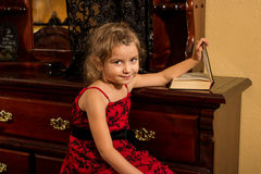 Little girl indoor with a book Royalty Free Stock Photography
