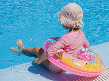 Little girl with inflatable circle at pool Stock Photo