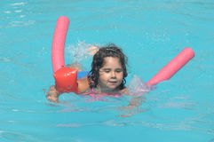 Little girl in inflatable over-sleeves floats Stock Image