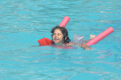 Little girl in inflatable over-sleeves floats Royalty Free Stock Photos