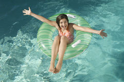 Little Girl On Inflatable Ring With Arms Outstretched Royalty Free Stock Photos