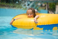 Little girl sitting on inflatable ring Royalty Free Stock Images