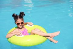 Little girl with inflatable ring in pool royalty free stock image