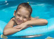 Little girl in inflatable swimming pool Royalty Free Stock Images