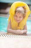 Little girl in inflatable waistcoat Royalty Free Stock Photo