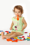 A little girl inflates balloons. Royalty Free Stock Images
