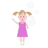 Little girl inflates soap bubbles Royalty Free Stock Images