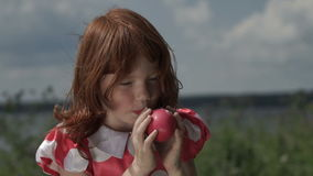 Little girl inflating balloon stock footage