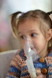 Little girl with inhaler Royalty Free Stock Photography