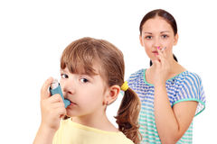 Little girl with inhaler Royalty Free Stock Images