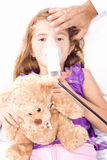Little girl inhaling medicine Royalty Free Stock Photos