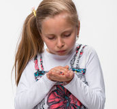 Little girl with a injured finger Stock Photo