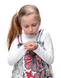Little girl with a injured finger Stock Image