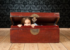 Little girl inside an ancient trunk Stock Photography