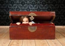Little girl inside an ancient trunk Stock Photography