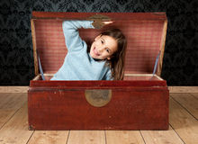 Little girl inside an ancient trunk Royalty Free Stock Photo