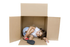 Little girl inside a Box. Isolated on white Royalty Free Stock Photos