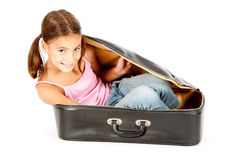 Little girl inside a suitcase Stock Photo