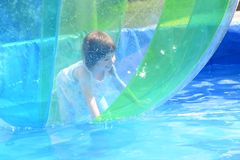 Little girl inside a water ball stock images