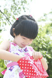 Little girl inspecting Stock Photography
