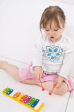 Little girl with instrument. Sweet toddler little girl with instrument Royalty Free Stock Photo