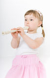 Little girl with instrument Royalty Free Stock Photo