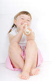 Little girl with instrument Royalty Free Stock Photography