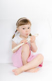 Little girl with instrument Royalty Free Stock Image