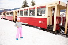 Little girl inviting to old geogrian train Kukushka, Bakuriani, Georgia stock images