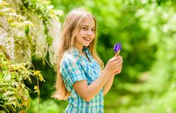 Little girl and iris flower. happy child hold iris flower. summer vacation. Green environment. Natural beauty. Childhood. Happiness. florist. Spring holiday royalty free stock photos