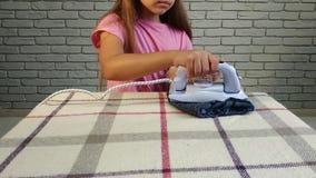 Little girl iron stock video