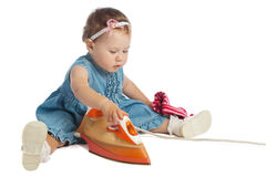 Little girl ironing Stock Photo