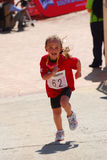 Little girl Ironkids athlete Stock Images