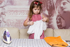 Little girl irons clothes Royalty Free Stock Photo