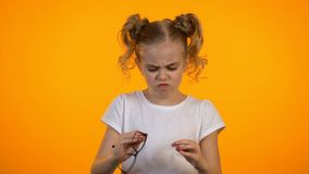 Little girl irritated with eyeglasses children ophthalmology eyesight correction. Stock footage stock footage