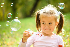 Free Little Girl Is Blowing A Soap Bubbles Stock Image - 21556311