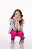 Little girl isolated on white background. Studio shot. Royalty Free Stock Photos