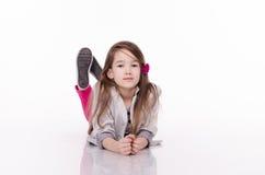 Little girl isolated on white background. Studio shot. Royalty Free Stock Images