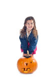 Little girl with jack-o-lantern Royalty Free Stock Photography