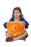 Little girl with jack-o-lantern Stock Photo