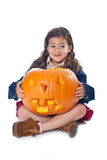 Little girl with jack-o-lantern Stock Image