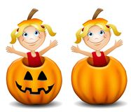 Little Girl in Jack O Lantern Stock Image