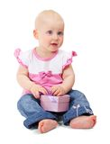 Little girl in jacket and blue jeans with gift box Royalty Free Stock Image