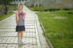 Little girl in jacket on sidewalk Royalty Free Stock Photos