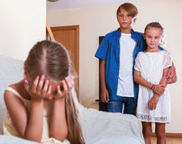 Little  girl  is jealous sister of stepbrother Stock Photos