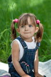 Little girl in jeans outdoor summertime Royalty Free Stock Photos