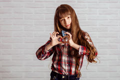 Little girl in jeans and a plaid shirt Stock Images